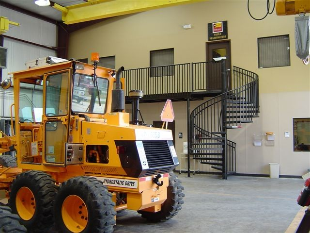 High Quality The Caterpillar Mustang Distributor Of Houston, TX Approached Us With The  Idea Of Using A Spiral Stair To Access Their Upper Mezzanine In The  Warehouse.