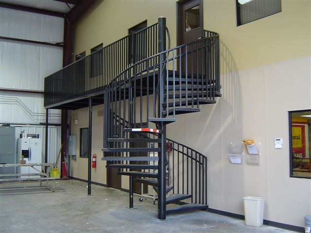 Captivating The Caterpillar Mustang Distributor Of Houston, TX Approached Us With The  Idea Of Using A Spiral Stair To Access Their Upper Mezzanine In The  Warehouse.